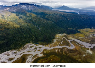Winding braided river and mountains dominate Alaska landscape