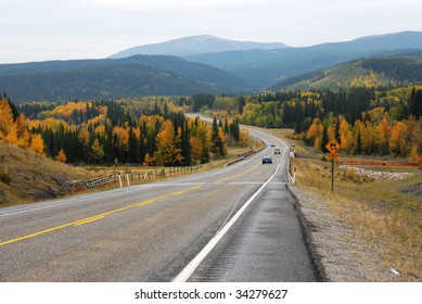 Winding country road in the elbow river valley, alberta, canada