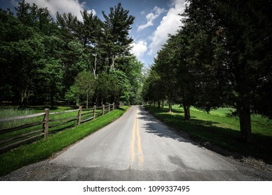 A winding country road on a beautiful day in Frederick County near Sugarloaf Mountain in western Maryland.