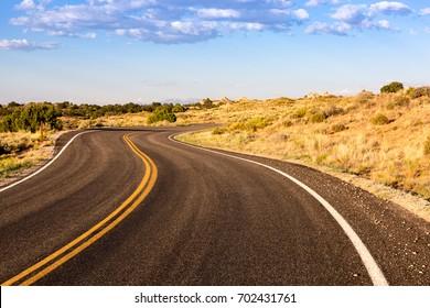 Winding Desert Road at Sunset
