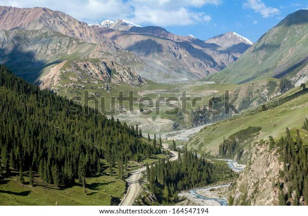 Winding dirt road going to Kumtor gold mine through Sary-Moinok pass. Kyrgyzstan
