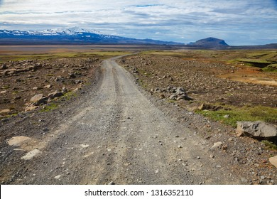 Winding gravel road leading to the Hekla (Hecla)  stratovolcano, one of Icelands most active volcanoes and popular tourist attraction in Southwestern Iceland, Scandinavia