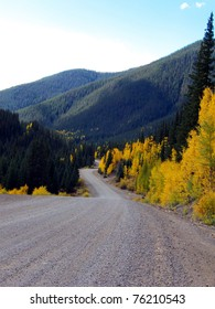 Winding gravel road through Aspen and Pine in the Rocky Mountains of Colorado