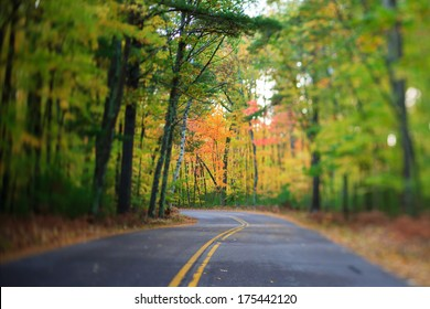 Winding Highway Road Through Fall Trees and Leaves in the North Woods, Wisconsin
