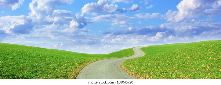 winding hiking trail and cloudy blue sky