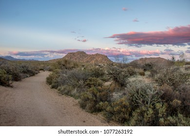 Winding hiking trail with high clouds in Mcdowell Mountains in Scottsdale, AZ.