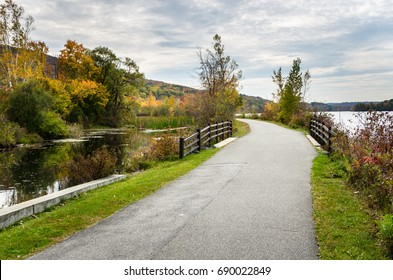 Winding Lakeside Path for Pedestrians and Cyclists in The Berkshires, MA, on a Cloudy Autumn Day.