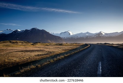 Winding mountain road next to Hvalfjordur fiord in Iceland