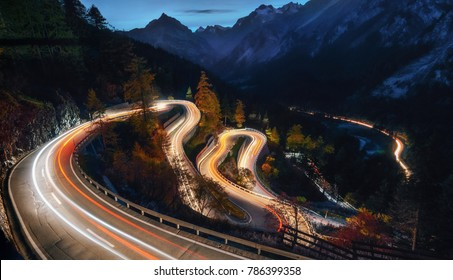 The winding mountain road at the night with light tracks from cars, Maloja Pass, Switzerland