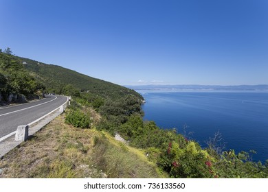 A winding mountain road over the sea