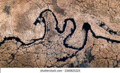 Winding river and brown swamps, aerial view
