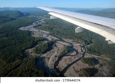 Winding river in taiga forest plane view before landing in Magadan, Far East Russia