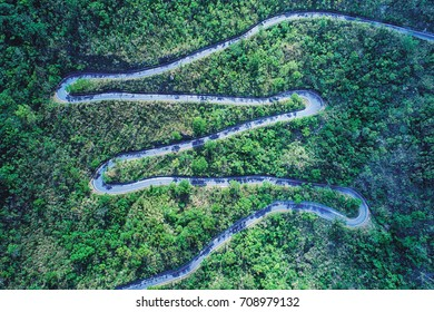 Winding Road Aerial Photography - road in forest on the mountain birds eye view use the drone photography, with sunlight and shadow in afternoon, shot in Toucheng Township, Yilan, Taiwan.