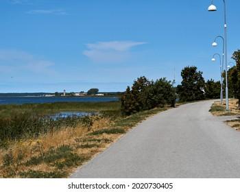 A winding road along the Baltic Sea coast.