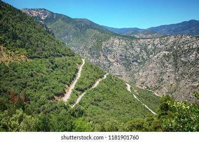 winding road crosses mountain in Peloponnese, Greece