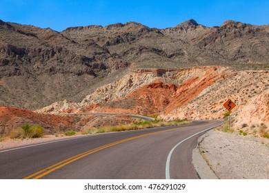 Winding road in dry dessert landscape