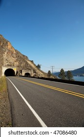 Winding road going to tunnel daytime