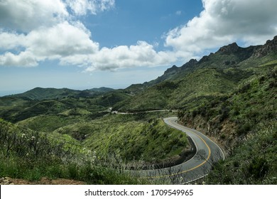 The winding road is in harmony with the hill