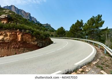 Winding road leading to The Benedictine abbey of Santa Maria de Montserrat, Catalonia. Spain