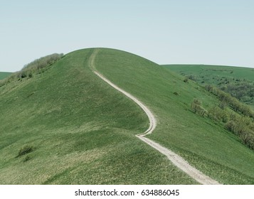 Winding road leading to the peak of mountain in summer.