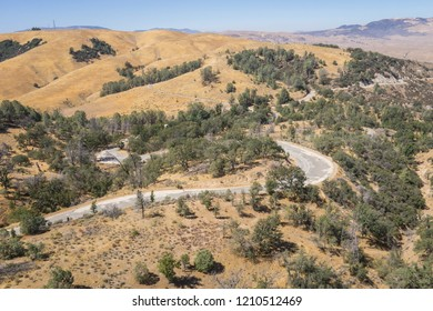 Winding road leads through the hills of southern California's wooded wilderness.