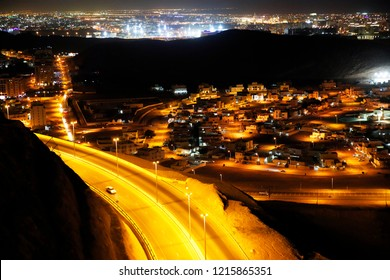 Winding road at night, Muscat, Oman