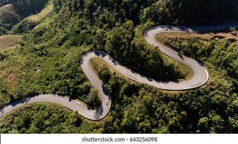Winding road on hill is like a snake.