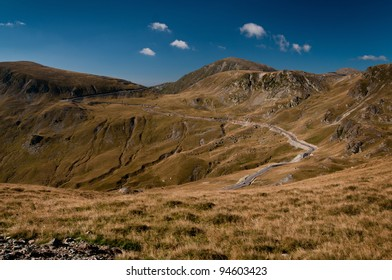 Winding road on top of the mountain - high altitude road - danger - Transalpina
