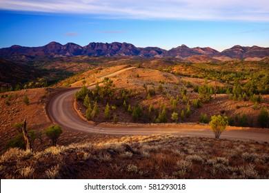 A winding road runs through Bunyeroo Valley in the Flinders Ranges National Park, South Australia, Australia - Outback Australian road.