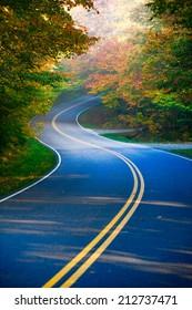 Winding road through autumn trees, Stowe Vermont, USA
