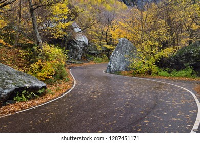 Winding road through boulders at Smugglers Notch State Park Vermont