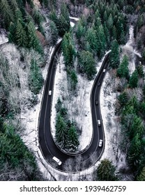 Winding road through the forests of Carpathian mountains; scenic rides, thrilling vibes