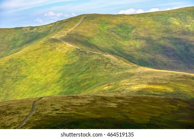 winding road through large meadows on the hillside of Polonina mountain range