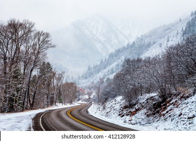 Winding road through a snowy scene. Colorado Highway 133 between Carbondale and Redstone