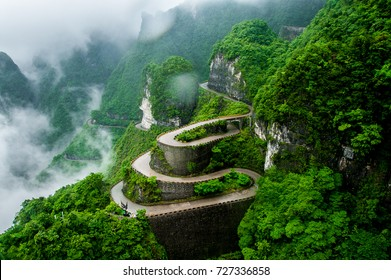 The winding road of Tianmen mountain national park (Zhangjiajie) in clouds mist, Hunan province, China