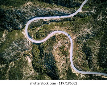 Winding road top aerial view drone shot, Sithonia, Greece
