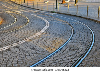 Winding road with tram lines