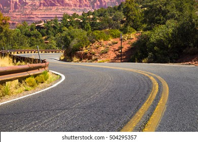 Winding road with yellow dividing lines through Arizona