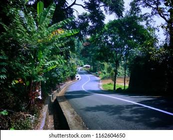 Winding Roads Gutter and Natural Scenery At Munduk Village, Buleleng, Bali, Indonesia