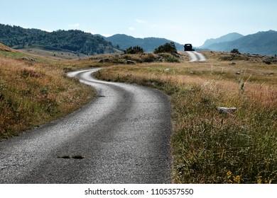 winding rural road in Lukavica Plateau, Montenegro