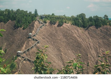 A winding staircase on a steep cliff