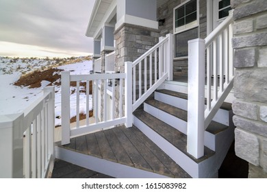 Winding wooden stairs to a house front door