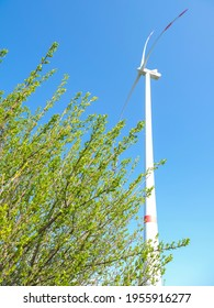 Windmill against blue sky in sunshine