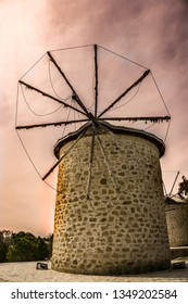 Windmill in Alacati, Cesme in Izmir. Popular iconic building of tourism destination where is known Alacati. Windmill on sunset sky background.
