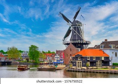 A windmill along the canals in Haarlem, Netherlands on a clear day.