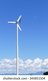 windmill with blue sky background for electricity production