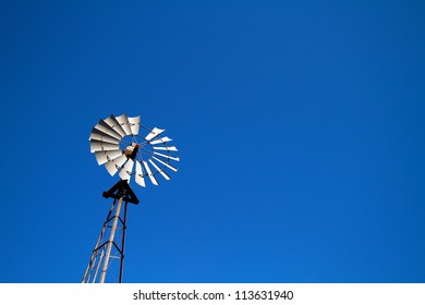 Windmill with blue sky plenty of room for text