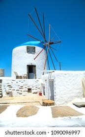 Windmill in a blue sky in Sifnos in Greece in a cycladic village