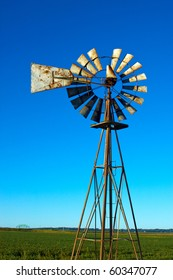 Windmill with a brilliant blue sky