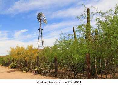 Windmill and butterfly garden along a fence on the La Posta Quemada Ranch with copy space in Colossal Cave Mountain Park in Vail, Arizona, USA near Tucson.
